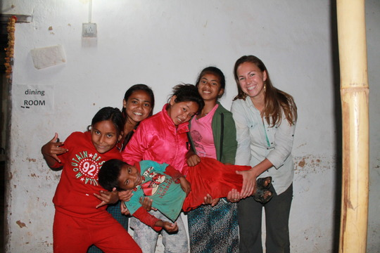 Lisa   our volunteer from  the USA with the kids