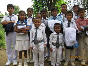 The children with  their new school dress