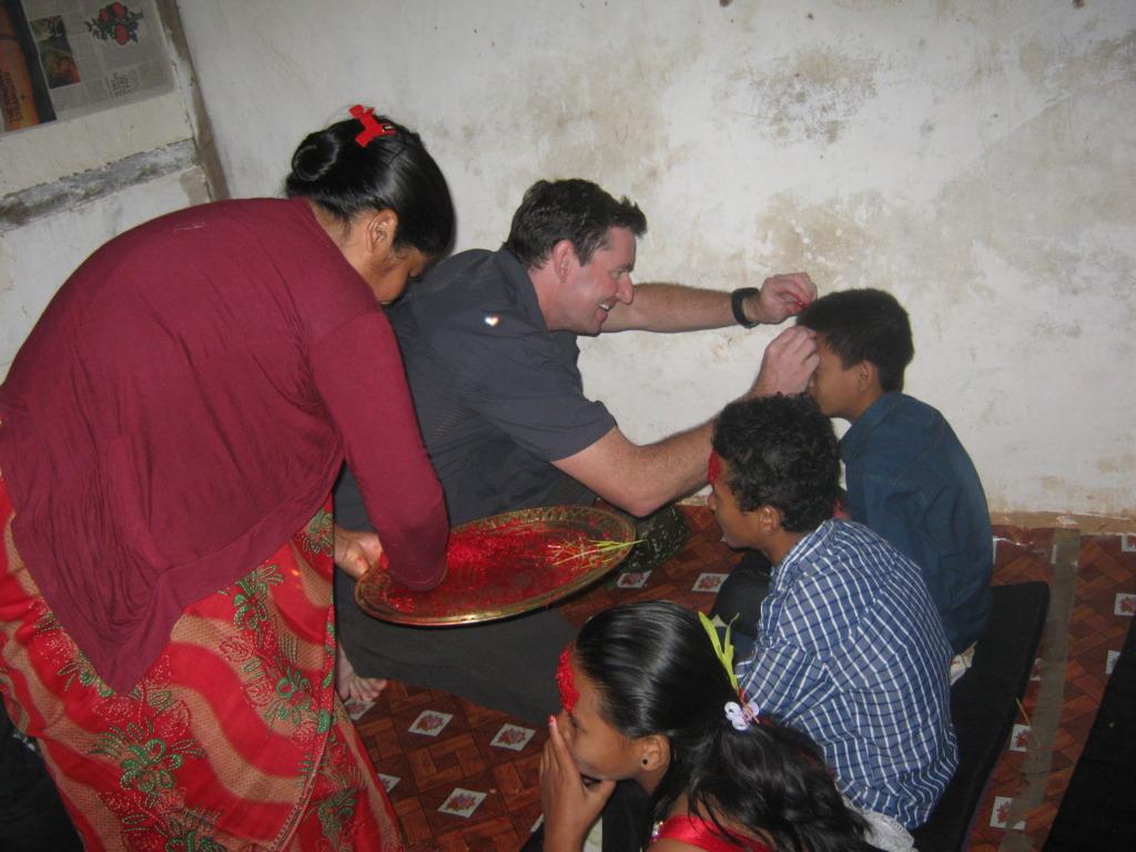 Michael providing Tika to the kids