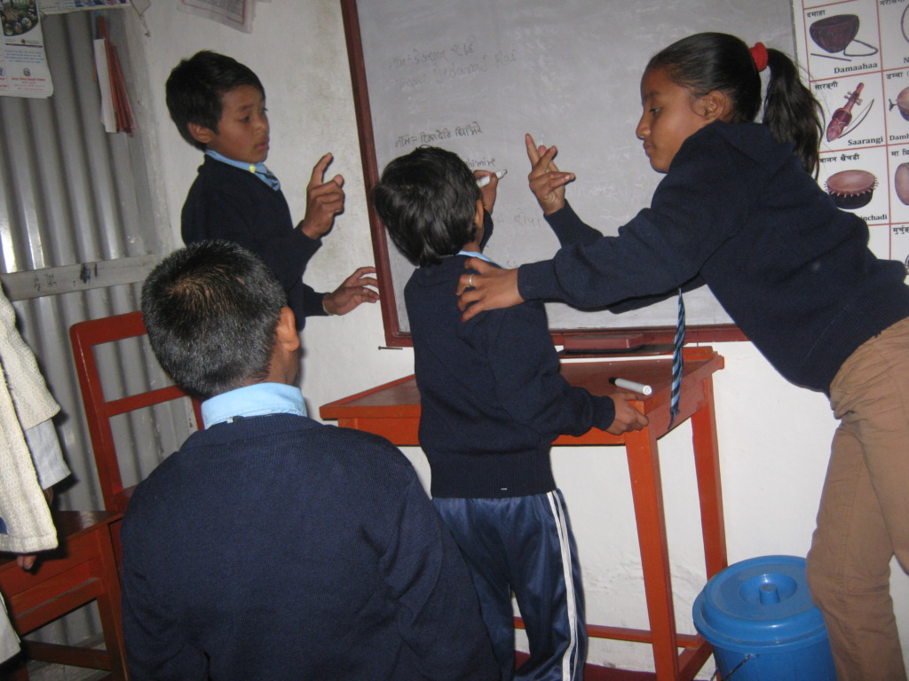 Kids  teaching to  each other