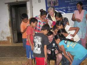 Michael and his mom visiting the orphanage
