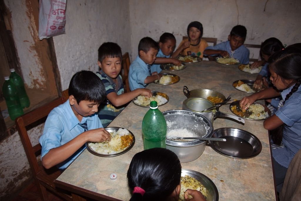 Children having their lunch at  the orphanage