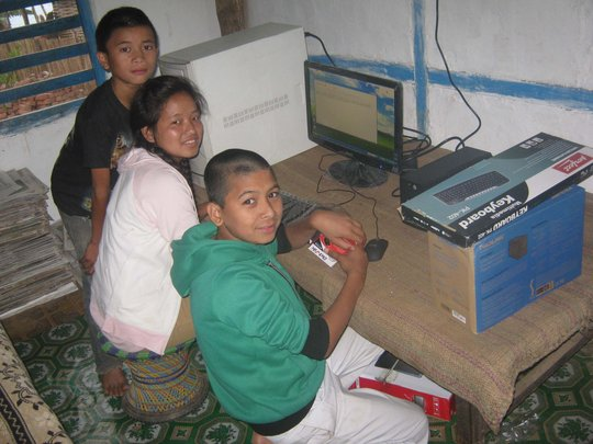 The children  learning how to use computer