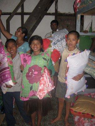 Children receiving bed clothes