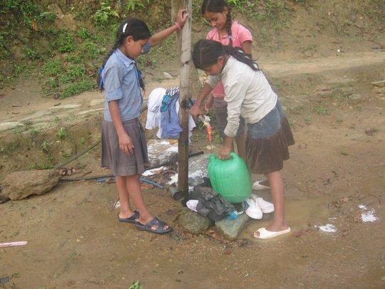 Children filling the water pot