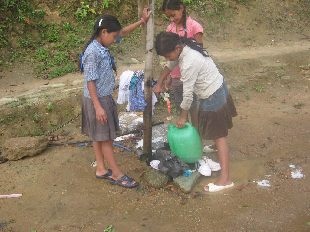 Children filling the water pot