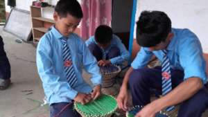 The kids at the special school  making chair