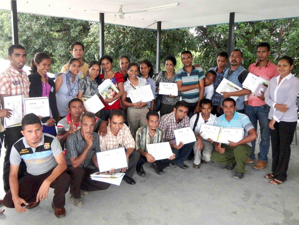 Teachers receive their training certificates.