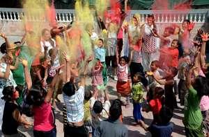 Celebrating Holi festival in Raksha Nepal
