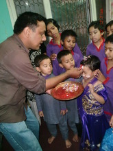 Project Leader with children....