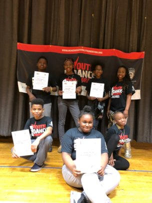 Students with their Certificates of Achievement