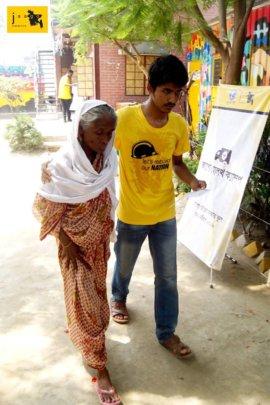 JAAGO Senior Student helping an Elderly