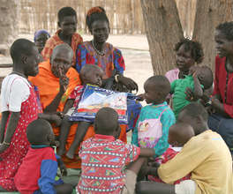 Village elders sharing information about bed nets