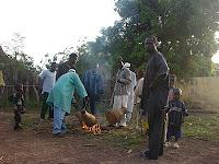 Preparing drums for celebration at Djendji village