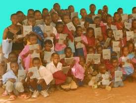Children (OVC) receiving uniforms and books