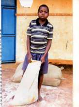 Young boy taking home food supply