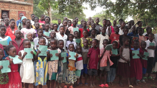 OVC children receive exercise books