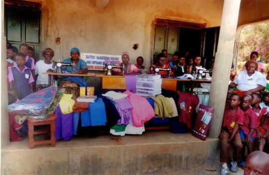 Bugiri Womens Group sewing uniforms for kids