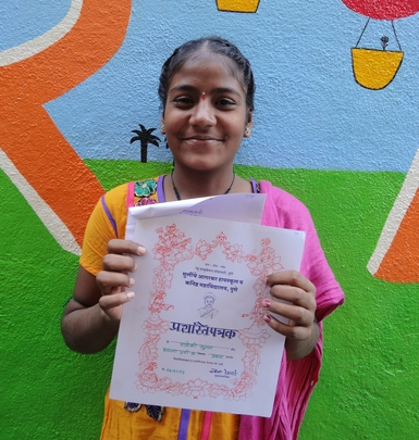 Suman and her certificate of achievement