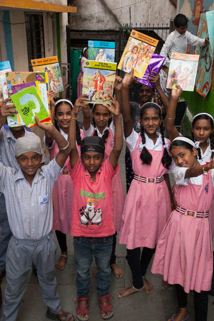 Distributing books to students
