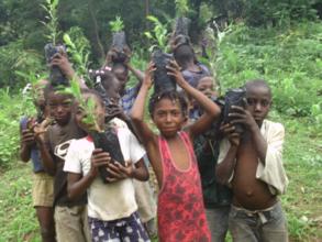 Children hold up seedlings in Bethel
