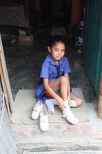 In the camp: A student getting ready for school