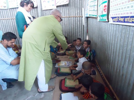 Anwar Khan, greeting Rangpur Preschool kids