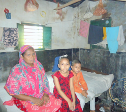 Zahid with his mother and sister at their home