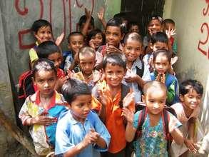 Children standing outside their preschool