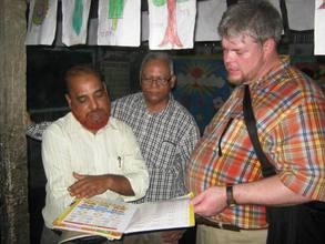 From right: Carey Craig, Anwar Khan, Sohail Akhter