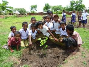 Students planting fruit trees with FTPF
