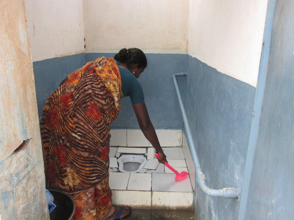Sanitation worker at her job