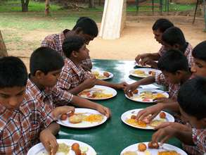 Children having food at the hostel