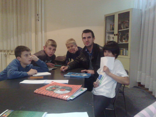 Students studying with our Program Coordinator Adi