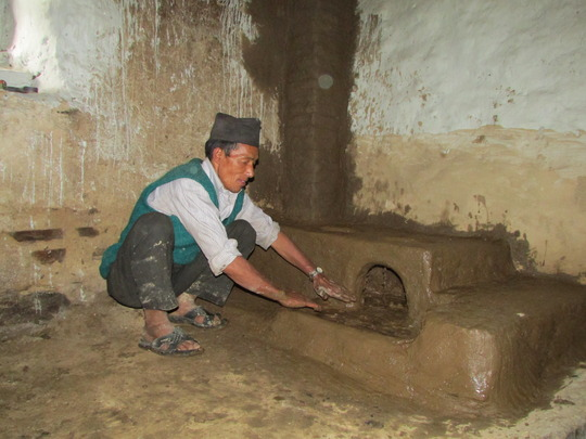 HHC employee, Bin Tapa finishing a cookstove