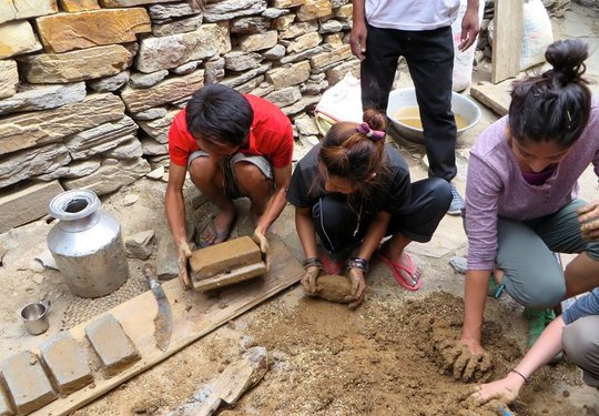 Making bricks to build an efficient cookstove!