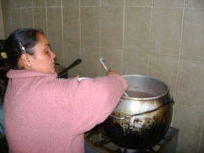 Community Mother preparing the food