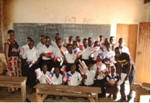 Pupils receiving packages of resuable pads