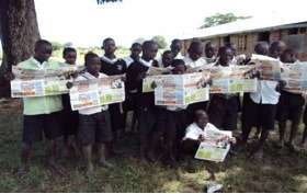 Pupils posing with copies of Young Talk