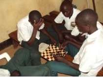 In-school youth playing indoor games at the center