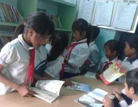 Tribal students enjoying their books