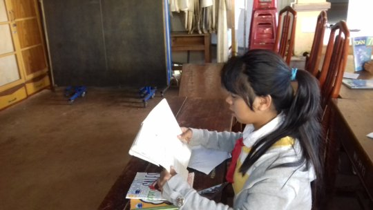 A tribal girl studying alone during lunch break