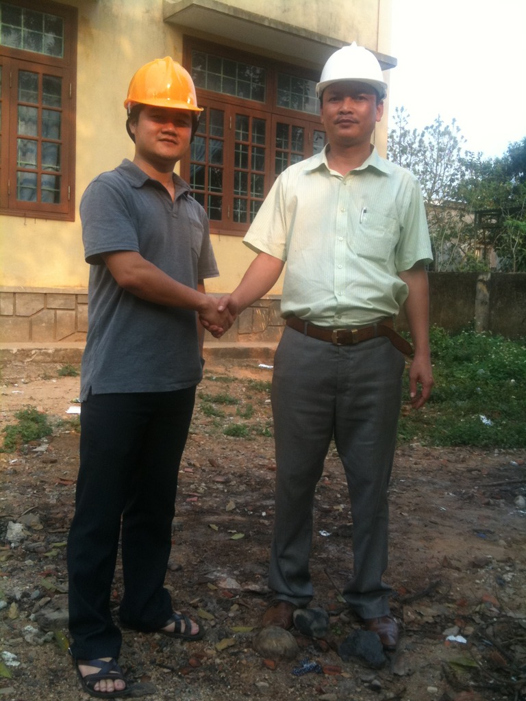 Tam of GCSF with contractor at building site