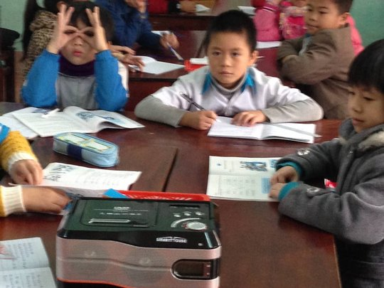 Students using cassette player in English class