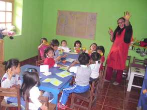 Our local teacher, Maribel with the littlest ones