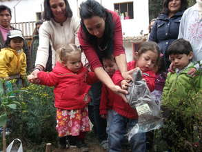 Kids helping to plant our tree