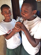 Sega students drink captured rainwater