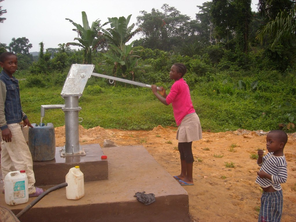 Another girl pumping for water