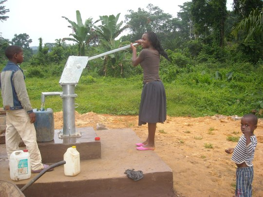 Girl pumping for water