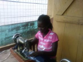An ex-child slave in dressmaking training